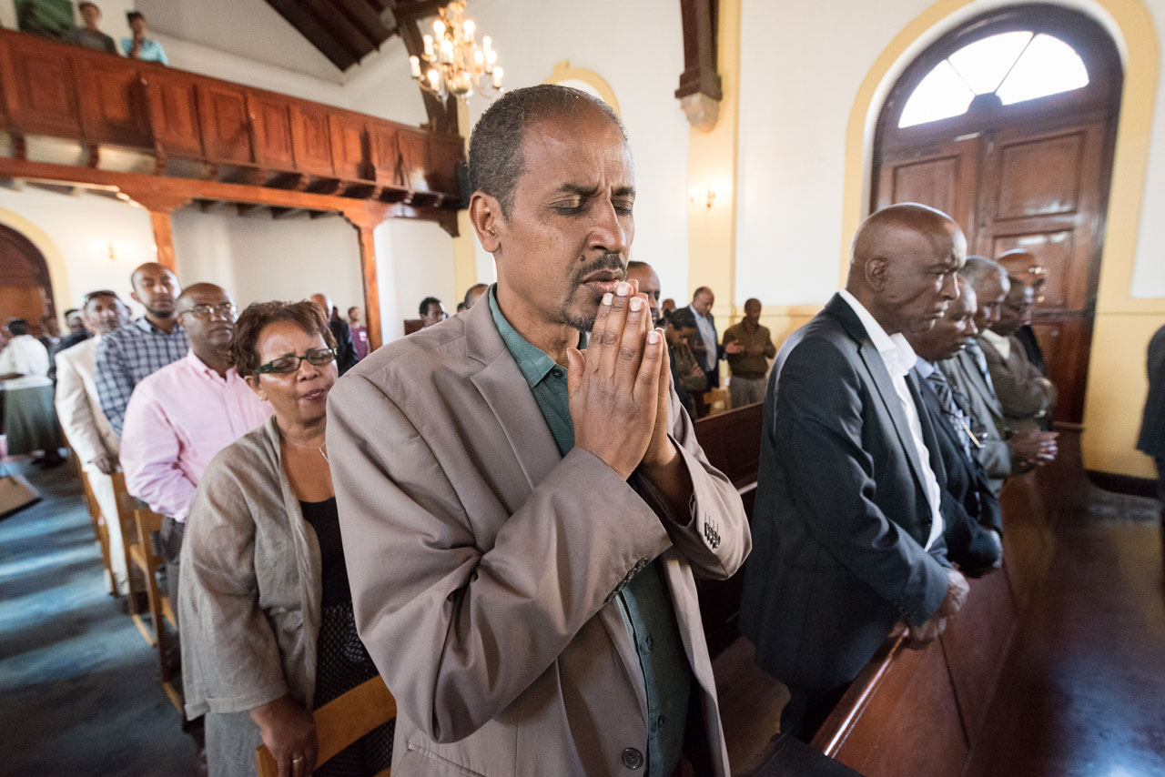 Congregants share a moment of prayer in the Addis Ababa Evangelical Church Mekane Yesus, Ethiopia.