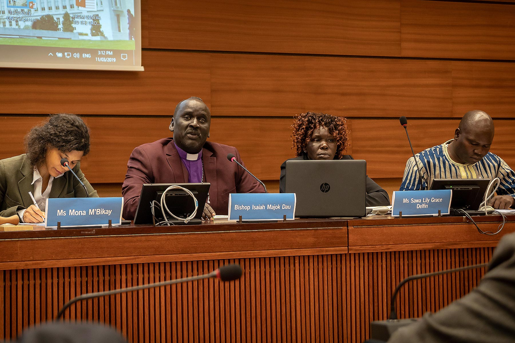 South Sudan civil society representative Ms Lilly Grace Delfin (second right) said there are critical gaps in addressing gender-based violence. Panelists at the human rights side event moderated by Ms Mona M'Bikay, Executive Director, UPR Info (left) included Bishop Isaiah Dau, South Sudan Council of Churches (second left) and Mr Jame David Kolok Joshua (far right), South Sudan Civil Society Coalition on the UPR. LWF/A. Danielsson