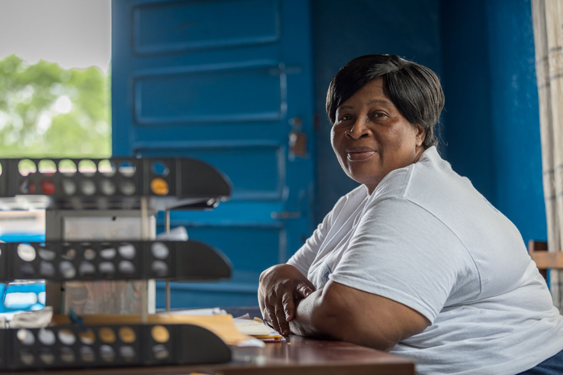 Mariama Z. Brown sits in her office at Mother Tegeste Stewart.