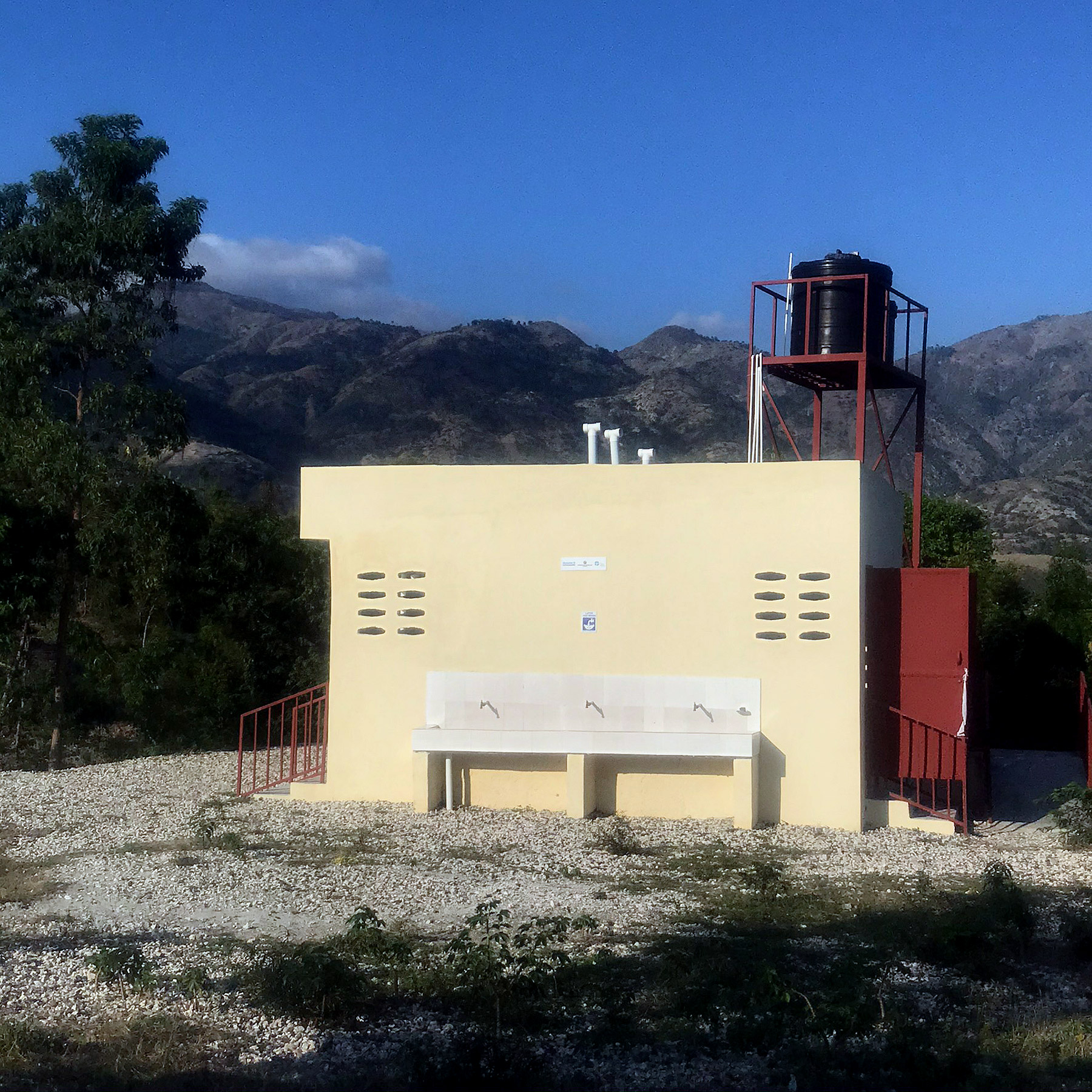 A new toilet block has been built for students at Vieux Caille school with a water tank on the roof to serve the handwashing stations
