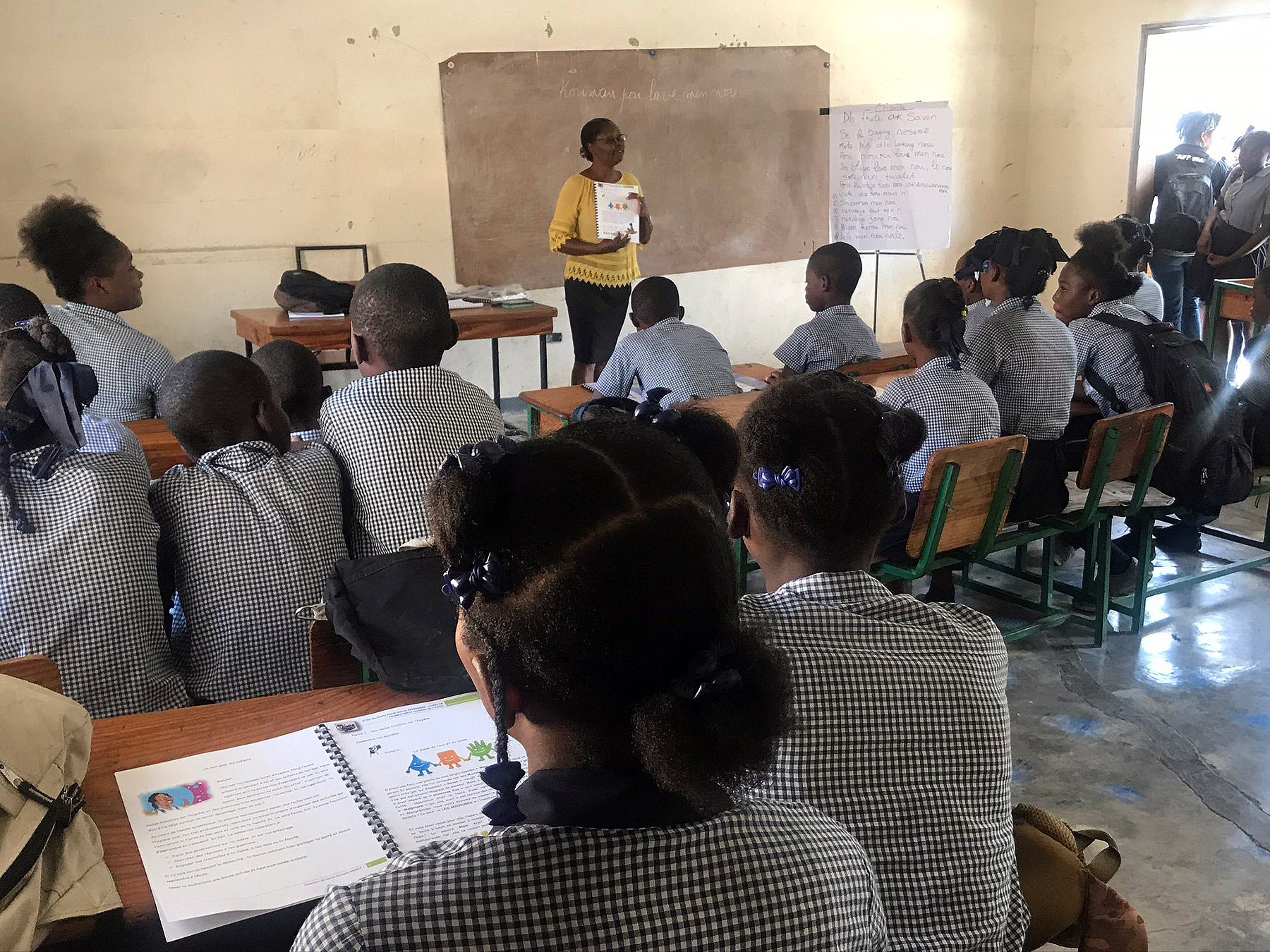 Students in a class at Gressier National School learn about how to prevent the spread of infection