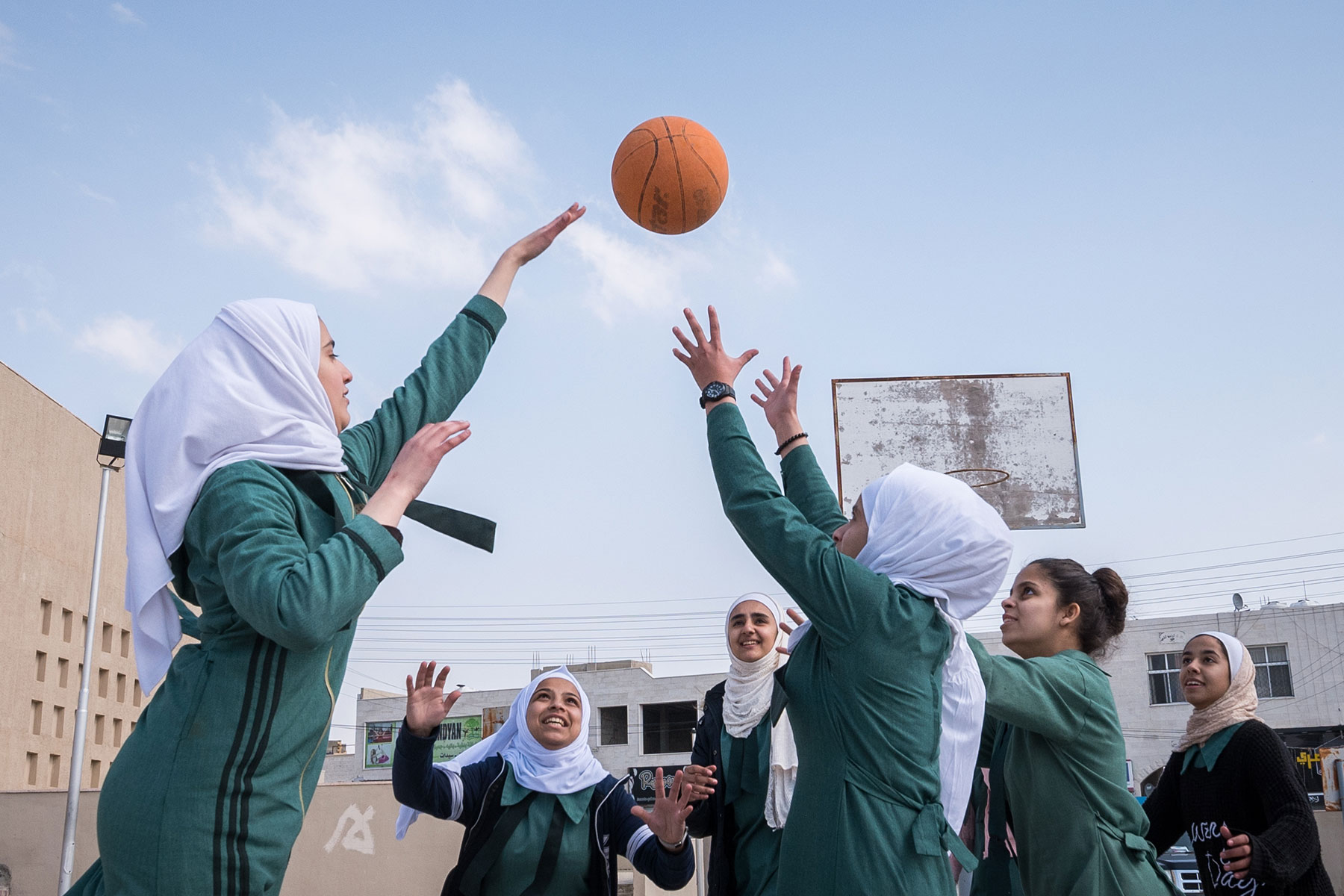 Basketball training is underway at Rufaida Al Aslamieh. The school serves more than 1,000 students from kindergarten age up to 10th grade, most of them girls from Jordan but also some from Syria and other countries.