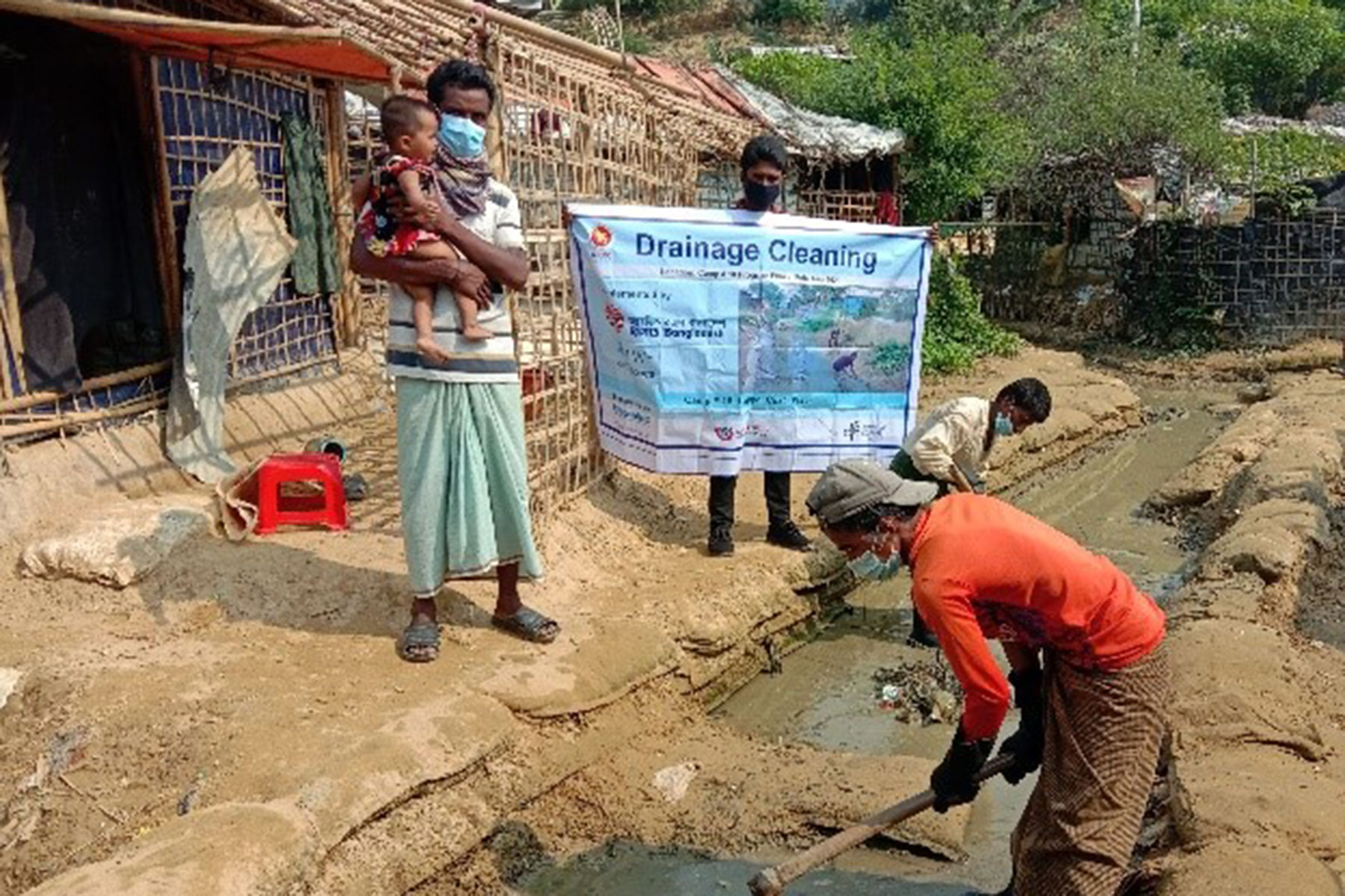 """""""There is a drainage right behind my house. During monsoon, the drainage line overflows due to clogging, and wastewater enters my house. RDRS Bangladesh supported the cleaning of these drains which from now on will keep my family, especially my children, safe from the dirty water and the diseases it brings,"""" said Abdul Malek (image)."""
