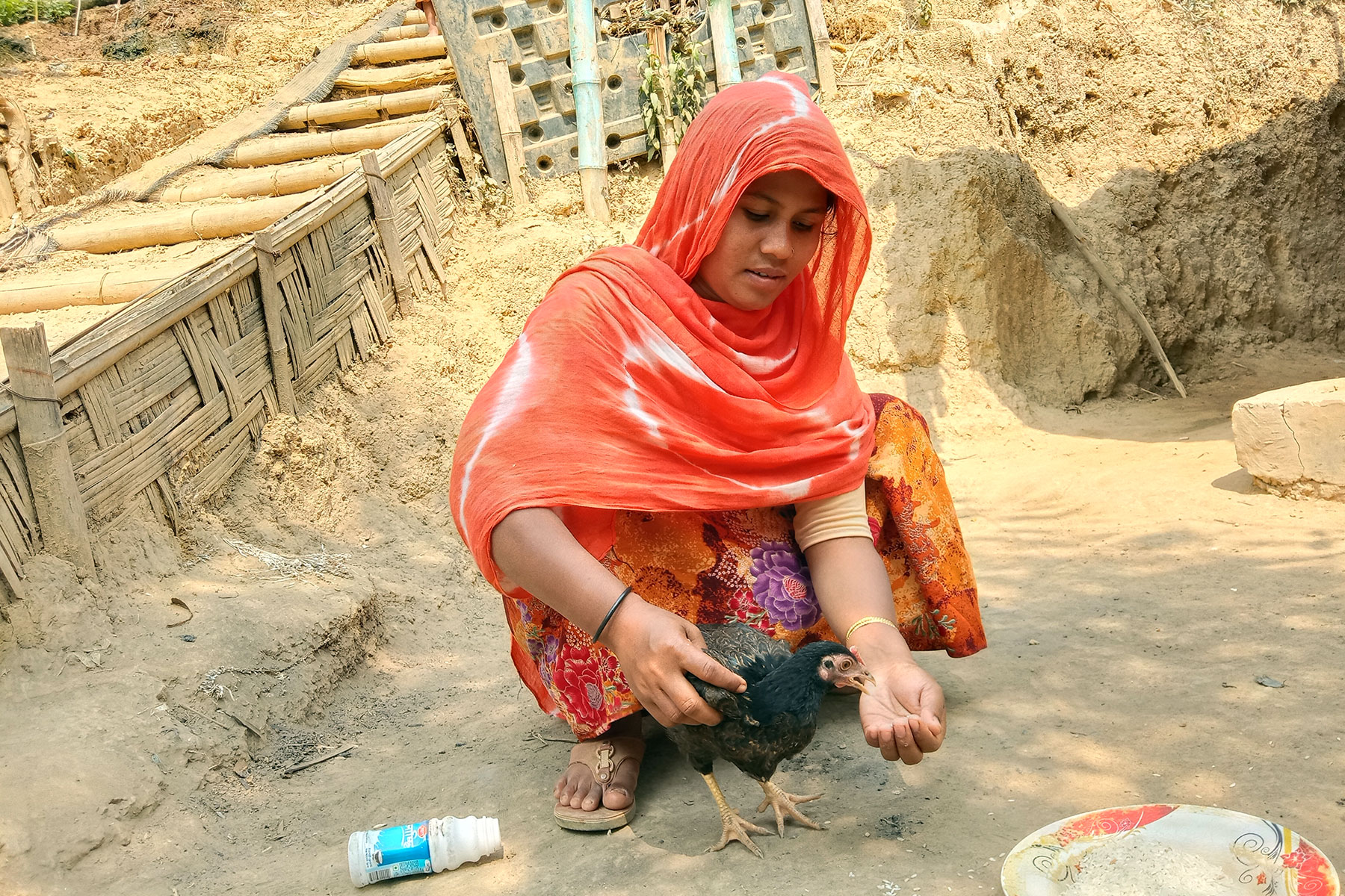 Cash for work schemes are a common way to provide people with employment and income. For single mothers and people living with disabilities however, opportunities are very limited. LWD/ RDRS in Bangladesh distributed poultry to women-headed households and persons with disabilities, to provide a home-based source of income. At the same time, having chicken and eggs at home improves the diet for the family. LWF also distributed additional food such as milk powder, seasonal fruit and sugar to nursing mothers. Photo: Bela Wadud, RDRS/LREP