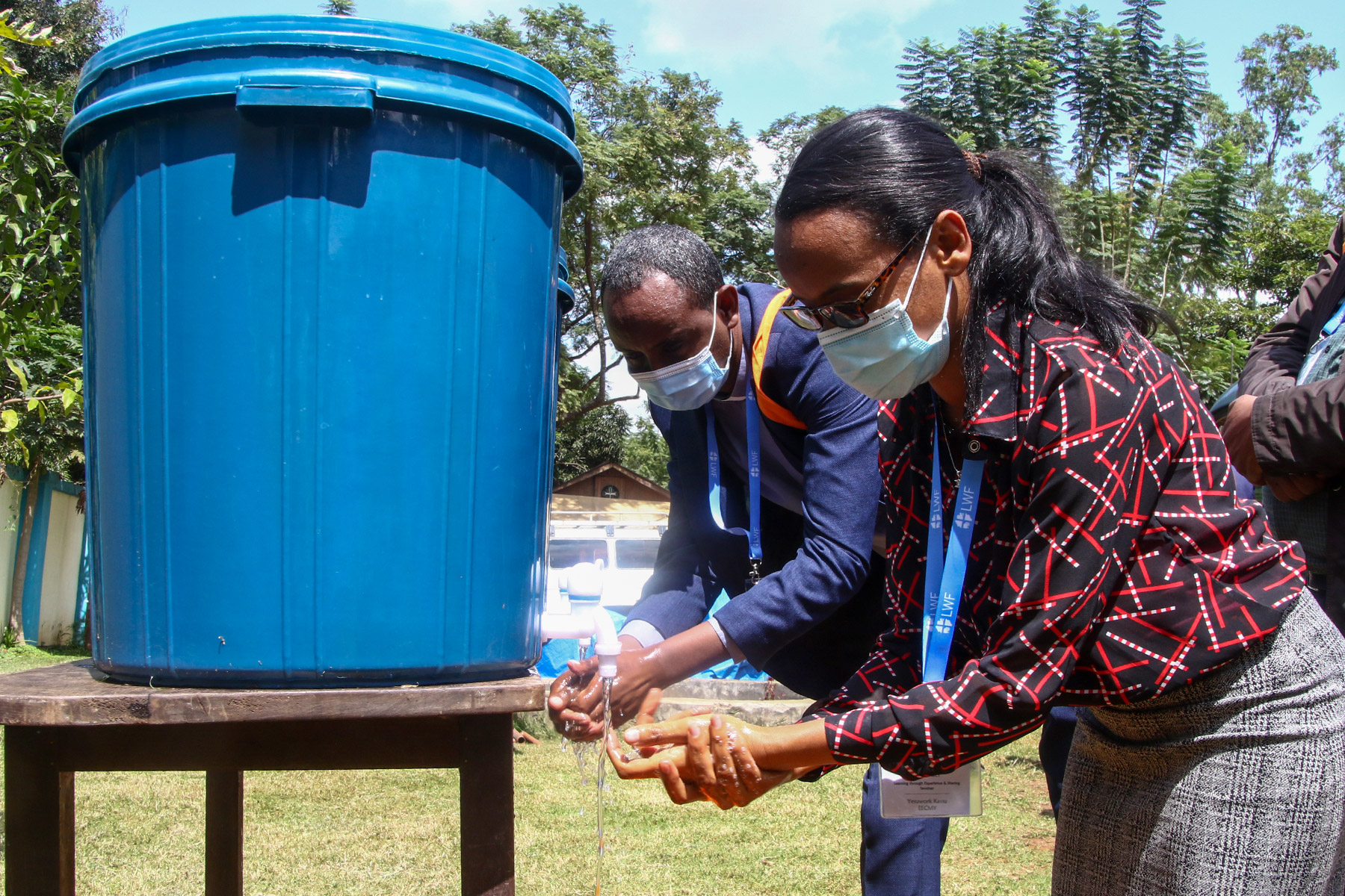 """Director of the EECMY Children's Ministry, Yesuwork Kassu, washes her hands after visiting the ELCT """"Radio Voice of the Gospel"""" in Moshi, Tanzania. E.Adolph/ELCT"""