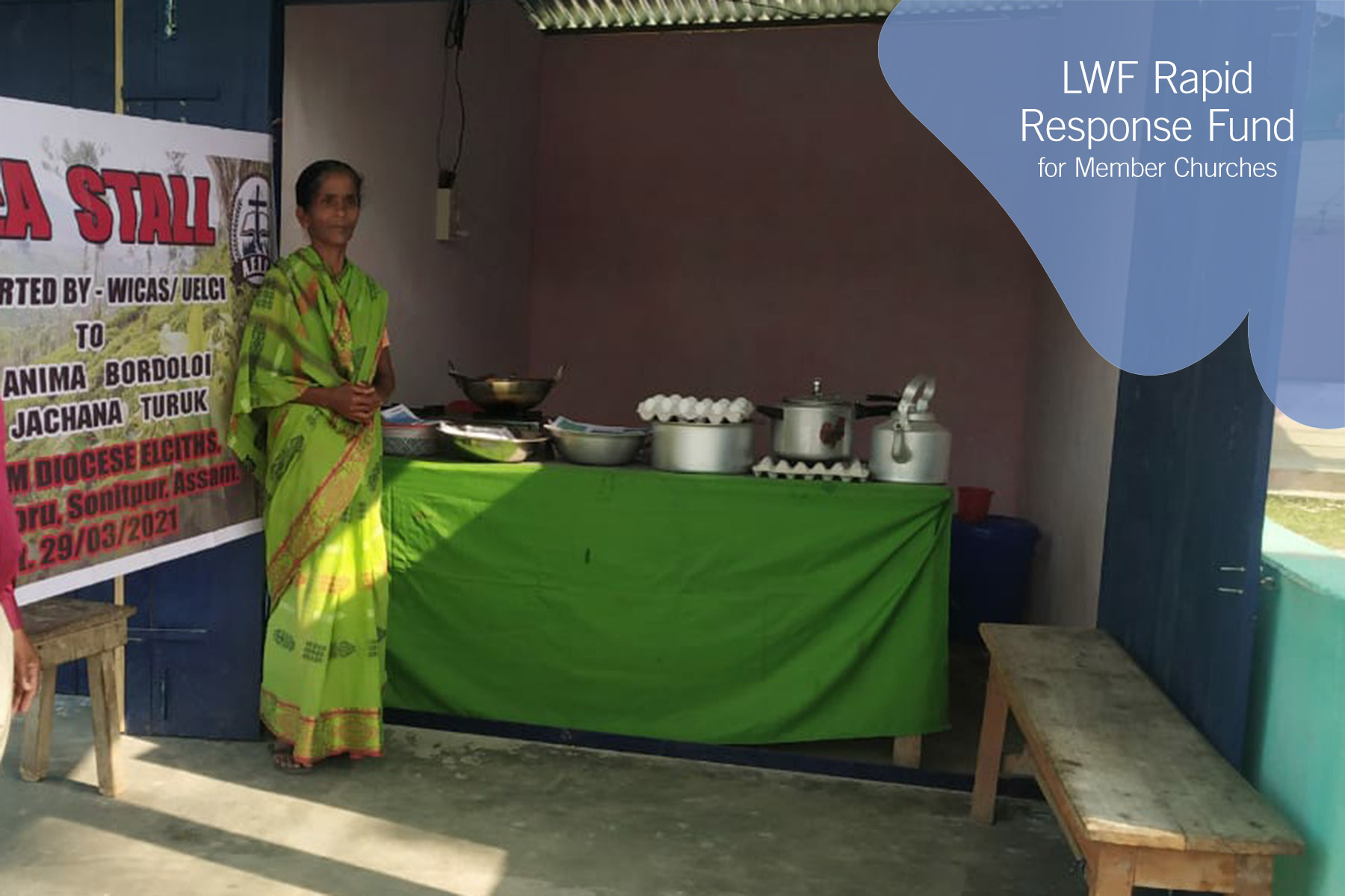 A new shop owner stands near her cooking supplies. UELCI