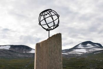 A monument marks the Arctic Circle in Saltfjellet, Norway. Snow previously covered these mountaintops all year round. Photo: Ryan Rodrick Beiler