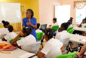 Women's centre in Kingston, Jamaica, offering education to young mothers so they can continue their education after giving birth. Photo: WCC/Peter Williams