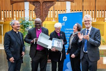 LWF President Archbishop Dr Panti Filibus Musa (second left) and Vice-President, Archbishop Dr Antje Jackelén (middle) unveil the publication, Resisting Exclusion- Global Theological Responses to Populism, together with General Secretary Rev. Dr Martin Junge (far right), co-editor Rev. Dr Simone Sinn (second right) and Rev. Dr Sivin Kit (far left), LWF program executive for Public Theology and Interreligious Relations. Photo: LWF/S. Gallay