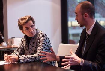 Martin Kopp (right), LWF delegate to the UN Climate Conference (COP19), speaks with Christina Figueres, director of UN Framework Convention on Climate Change. Photo: LWF/ Sean Hawkey