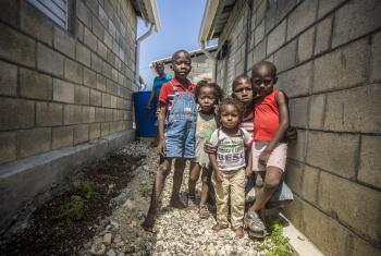 Tiny survivors of the 2010 Haitian earthquake gather outside the Model Resettlement Village in Gressier