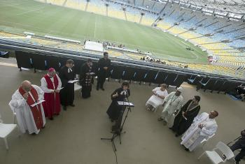 Rev. Lusamarina Campos leads an interreligious service in May in the Maracana arena in the lead-up to the 2014 FIFA World Cup in Brazil. Photo: Vitor Jorge