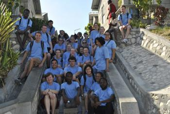 Students from Luther College in the United States take in sights and stories at LWF's model village in Gressier, Haiti.Photo: LWF/Helene Branco