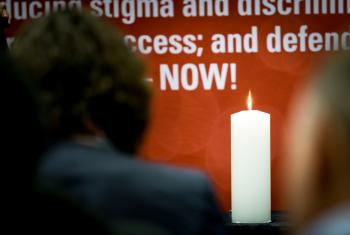 A candle is lit on the first day of Faith on the Fast Track, a meeting of faith organizations ahead of AIDS2016. Photo: WCC/Albin Hill