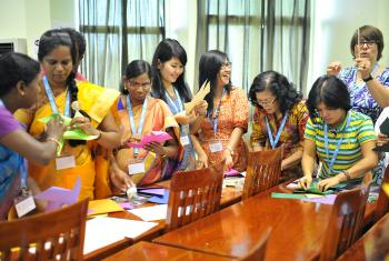 Women delegates from LWF member churches in Asia make paper windmills at the Women in Church and Society meeting, held before the regional Pre-Assembly. Photo: LWF/A. Danielsson