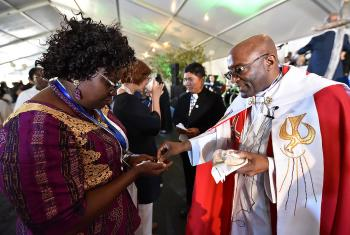 10 May 2017, Windhoek, Namibia: Bishop Ernst Gamxamub from the Evangelical Lutheran Church in the Republic of Namibia distributes bread during Holy Communion at the opening worship of the Lutheran World Federation's Twelfth Assembly.  Photo: LWF/Albin Hillert