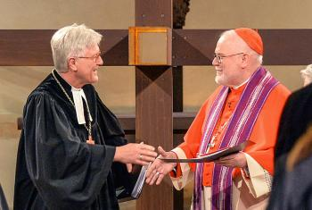 The Bavarian Bishop and EKD Council Chairperson Heinrich Bedford-Strohm (left) and the Chairperson of the Catholic German Bishops' Conference, Cardinal Reinhard Marx, exchanging a sign of peace during the service of reconciliation taking place in Hildesheim, Germany, in during the 2017 Reformation commemoration. Photo: epd/Jens Schulze