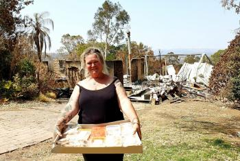 Sue Cutting, a foster mum of seven who lost her house in the fires, was delighted to receive food relief from Adelaide Hills Lutheran and community volunteers. Photos: LCA