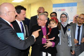 The ribbon cutting ceremony, led by Bishop Munib A. Younan, holding a child who may be undergoing a bone marrow transplantation in the newly opened Bone Marrow Transplant Unit. Photo: LWF Jerusalem