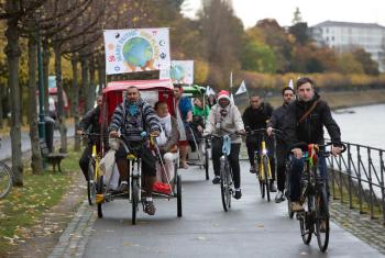 The statement was delivered by faith leaders on bicycles, promoting sustainable lifestyles. Photo: WCC/Sean Hawkey.