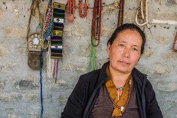 Tibetan refugee Kunsang Dolma sells jewelry made through LWF-training support for women groups. Photo: LWF/Christopher Waddell