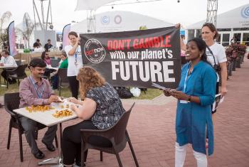 "ACT Alliance climate campaigners staged a protest ""Don't Gamble with our Future"" as the UN climate talks drew to a close. Photo: LWF/Sean Hawkey"