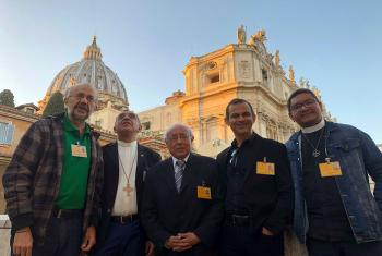 Rev. Nicolau Nascimento de Paiva (left of photo) together with other ecumenical delegates to the Vatican Synod in front of St Peter's Basilica. Photo: Robert FLOCK