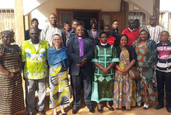 Bishop Dr Ruben Ngozo, center, LWF Area Secretary for Africa, Rev. Dr Elieshi Mungure, to his left, and LWF Vice President for Africa, Rev. Dr Jeannette Ada Epse Maina, second from right, outside the Evangelical Lutheran Church in Cameroon. Photo: LWF