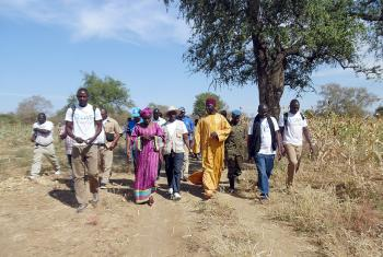Staff, beneficiaries and visitors visiting project fields in Kimiti department. Photo: LWF Chad