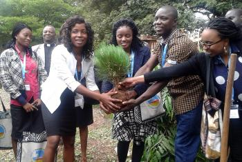 Members of the LWF Global Young Reformers' Network in Africa, plant a tree during a May 2015 visit to Majengo Lutheran Parish in Moshi, Tanzania. Photo: LWF/Allison Westerhoff