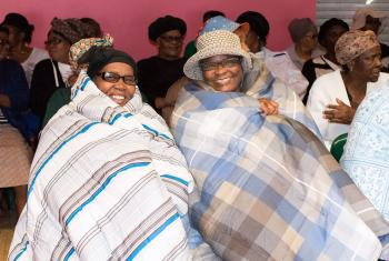 Quilts are handed out to the Busiswe Luncheon Club, South Africa. The club is a group of elderly who meet daily to sing, share meals, and support each other while their families are working and in school. All photos: CLWR