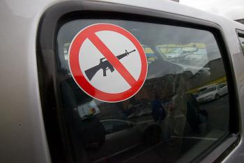 A sticker advises that weapons are not carried in the vehicle. Photo: ACT Alliance