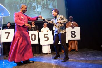 Christiana Figueres, Executive Secretary of the United Nations Framework Convention on Climate Change, dances with Archbishop Thabo Makgoba of South Africa to celebrate some 1.8 million signatures on an interfaith petition for climate justice during the COP21 climate summit in Paris, France. Photo: LWF/R. Rodrick Beiler
