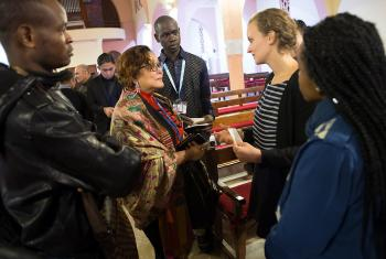 "LWF's representatives at the COP 22 talks in Marrakech, Morocco, participated in an ecumenical ""Prayer for the Planet"" at the Roman Catholic Church of the Holy Martyrs, 8 November. Gloria Jumamil-Mercado, head of the Philippine government delegation (center) meets LWF Youth Secretary Caroline Bader and LWF delegation members [l-r] Cédrick Yumba Kitwa (Democratic Republic of Congo); Pascal Kama (Senegal); and Ditebogo Caroline Lebea (South Africa). Photo: LWF/Ryan Rodrick Beiler"