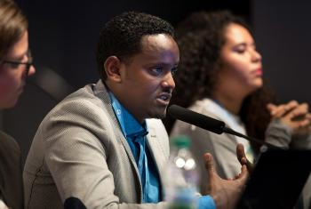 LWF Ethiopia program coordinator Biruk Kebede (center) speaks at the panel debate on Education, Youth and Climate Change at COP 22, in Marrakech, Morocco. Photo: LWF/Ryan Rodrick Beiler