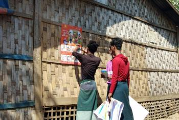 LWF is working in Myanmar's Rakhine, Chin and Kayin States to support awareness raising on COVID-19 prevention. Here, posters are distributed in local languages with information on hygiene and other measures to stop the spread of infection. Photo: LWF Myanmar