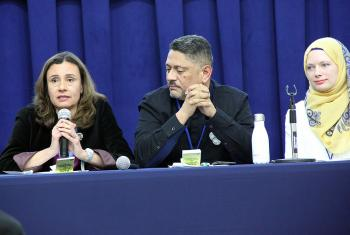 María Cristina Rendón, program assistant in LWF Women in Church and Society speaks at the panel discussion. With her is LWF delegate Larry Madrigal Rajo, and Iman Sandra Pertek (right).