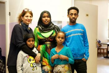 Refugee family with caretaker, left, at the refugee home Rossauer Lände, Austria. Photo: Diakonie Refugee Service Austria/ Nadja Meister