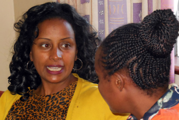 Genet Girma Eshete of Ethiopia talks to another particpant during the LWF Diakonia and HRM workshop in Nairobi. Photo: LWF/Afram Pete