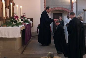 Württemberg Bishop Dr Frank O. July is installed as the new chairperson of the German National Committee, in Hanover, Germany. Photo: GNC
