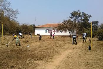 EELCO youth clear church grounds where new trees will be planted. Photo: Cedrick Y. Kitwa