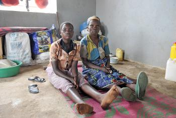Caption: Bernadetta Myanura and her granddaughter Feza in the few square meters they have to themselves in the reception center. Photo: M. Renaux