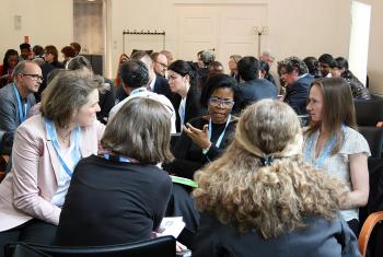 Pröpstin Astrid Kleist (left ) and Prof. Dr Puleng LenkaBula (center) in discussion during the conference in Berlin. Photo: LWF/ A. Weyermüller