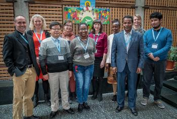 Members of the LWF Theological Education and Formation advisory group stand before the Lund Cross in the chapel of the Ecumenical Centre in Geneva. Photo: LWF/S. Gallay