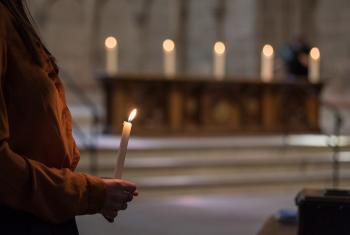 16 June 2019, Geneva, Switzerland: Gathered in Saint Peter's Cathedral in central Geneva, Emma van Dorp, a theology student from the Reformed congregation, lights five symbolic candles on the altar as the church leaders affirm the 'wish to make more visible our common witness in worship and service, on our journey together towards visible unity.' Photo: LWF/Albin Hillert