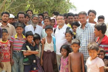 Bhoj with camp management committee members and children in an IDP camp in Sittwe. Photo: LWF Myanmar