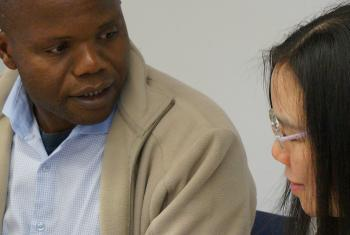 Dr Mahali in discussion with another conference participant. Photo: LWF/I. Benesch
