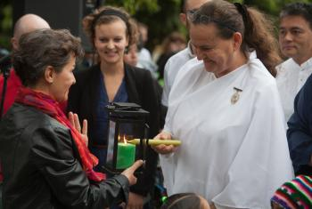Christiana Figueres, UNFCC Exec. Secretary receiving the light during an Interfaith vigil, with Caroline Richter, LWF and faith members of Brahma Kuaris, LWF/Sean Hawkey