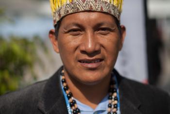 Activist displaying traditional headdress at COP20. Photo: LWF/Sean Hawkey