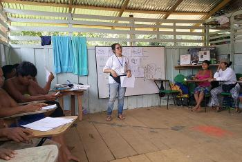 Yuri Guzman conducting a training session in Choco. She says humanitarian work allows her to offer solutions to the problems of people living in a conflict zone. Photo: LWF Colombia